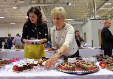 """<div class=""""source"""">KACIE GOODE/The Kentucky Standard</div><div class=""""image-desc"""">Guests select chocolate treats for their plates Saturday night during the annual Chocolate Extravaganza at the Guthrie Opportunity Center. The event is a fundraiser for The New Life Center, a family support program in Bardstown.</div><div class=""""buy-pic""""><a href=""""/photo_select/93330"""">Buy this photo</a></div>"""