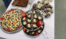 """<div class=""""source"""">KACIE GOODE/The Kentucky Standard</div><div class=""""image-desc"""">More than two dozen people helped prepare chocolate treats for Saturday's Chocolate Extravaganza, a fundraiser for The New Life Center.</div><div class=""""buy-pic""""><a href=""""/photo_select/93332"""">Buy this photo</a></div>"""