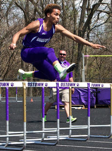 "<div class=""source"">Peter W. Zubaty</div><div class=""image-desc"">Bardstown senior Dallan Goldring is encouraged by coach Jeremy Dale (rear) in the 300 hurdles in Saturday's Clash of the Classes.</div><div class=""buy-pic""></div>"