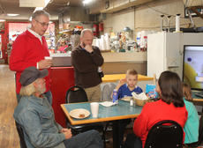 """<div class=""""source"""">RANDY PATRICK/The Kentucky Standard</div><div class=""""image-desc"""">State Sen. Jimmy Higdon, R-Lebanon, meets wtih constituents Saturday morning at High Grove Grocery  during the Coffee with Chad event sponsored by his colleague in the legislature, Rep. Chad McCoy, R-Bardstown.</div><div class=""""buy-pic""""><a href=""""/photo_select/83372"""">Buy this photo</a></div>"""