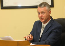 "<div class=""source"">RANDY PATRICK/The Kentucky Standard</div><div class=""image-desc"">County Attorney Matthew Hite asks a question of Bryan Bell, a senior manager for Bluegrass Cellular and his attorney, John Selent, about the KentuckyWired proposal. </div><div class=""buy-pic""><a href=""/photo_select/91163"">Buy this photo</a></div>"