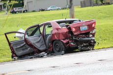 "<div class=""source"">KACIE GOODE/The Kentucky Standard</div><div class=""image-desc"">A vehicle is badly damaged following a three-car crash Monday evening on New Shepherdsville Road.</div><div class=""buy-pic""><a href=""/photo_select/67558"">Buy this photo</a></div>"