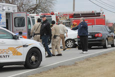 """<div class=""""source"""">RANDY PATRICK/The Kentucky Standard</div><div class=""""image-desc"""">Chaplain Tom Mobley, foreground, was on the scene of a head-on collision Saturday at the entrance to Greer Estates on Louisville Road, along with sheriff's deputies, firefighters and medical personnel.</div><div class=""""buy-pic""""></div>"""