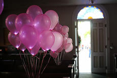 """<div class=""""source"""">KACIE GOODE/The Kentucky Standard</div><div class=""""image-desc"""">Balloons wait inside St. Thomas Parish as guests gather outside for a prayer service. </div><div class=""""buy-pic""""><a href=""""/photo_select/77549"""">Buy this photo</a></div>"""