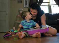 "<div class=""source"">KACIE GOODE/The Kentucky Standard</div><div class=""image-desc"">Ethan, 2, goes to give mom Courtney Anderson a kiss while playing inside his New Haven home.</div><div class=""buy-pic""></div>"