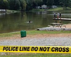 "<div class=""source"">KACIE GOODE/The Kentucky Standard</div><div class=""image-desc"">Police tape sections off a diving area as members of Louisville Metro Underwater Search and Rescue return to Melody Lake Wednesday. The diving team also visited in July, shortly after the disappearance of 35-year-old Crystal Rogers, but the police presence has not been confirmed to be releted to any investigation.</div><div class=""buy-pic""><a href=""/photo_select/69278"">Buy this photo</a></div>"