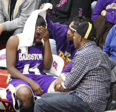 """<div class=""""source"""">Peter W. Zubaty</div><div class=""""image-desc"""">Bardstown forward Daizah Kimberland is consoled by her parents David and Frances """"Cocoa"""" Kimberland after the senior suffered a left knee injury in the third quarter Friday against Nelson County. Kimberland injured her right knee two years ago, which caused her to miss her entire sophomore season.</div><div class=""""buy-pic""""><a href=""""/photo_select/22655"""">Buy this photo</a></div>"""