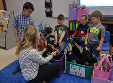"<div class=""source"">KACIE GOODE/The Kentucky Standard</div><div class=""image-desc"">Courtney Puckett looks at some of the gift bags students in Amy Brandenburg's class at Foster Heights donated to Norton Children's Hospital.</div><div class=""buy-pic""><a href=""/photo_select/90411"">Buy this photo</a></div>"
