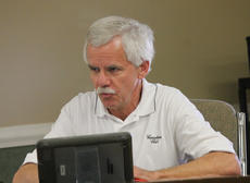 """<div class=""""source"""">RANDY PATRICK/The Kentucky Standard</div><div class=""""image-desc"""">Councilman Fred Hagan asked for an investigation of his iPad too because he said he said he uses it to take personal pictures and was never informed that he couldn't. Councilman Roland Williams said he has his personal email synched to his iPad.</div><div class=""""buy-pic""""><a href=""""/photo_select/80913"""">Buy this photo</a></div>"""