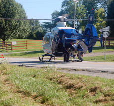 "<div class=""source"">TREY CRUMBIE/The Kentucky Standard</div><div class=""image-desc"">Several emergency crews responded to a two vehicle accident Friday at 9 a.m. on Springfield Road in Bloomfield. The accident caused the drivers of both vehicles to be transported to the University of Louisville. The driver of the Grand Marquis was airlifted to the University of Louisville via Air Methods Kentucky. </div><div class=""buy-pic""><a href=""/photo_select/68117"">Buy this photo</a></div>"