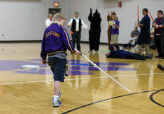 "<div class=""source"">KACIE GOODE/The Kentucky Standard</div><div class=""image-desc"">Sixth-grader Gabriel Schepker makes his way to the mock stage after being announced as the guest character in a Star Wars-themed skit at Bardstown Middle. Gabriel has a life-threatening heart condition and is in the process of getting on a list for a transplant.</div><div class=""buy-pic""><a href=""/photo_select/85713"">Buy this photo</a></div>"