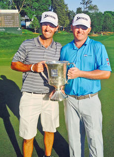 """<div class=""""source"""">Courtesy of the CKNJ</div><div class=""""image-desc"""">Campbellsville native and PGA touring pro J.B. Holmes, right, and his caddy, Brandon Parsons, pose with the cup after Holmes won the Wells Fargo Championship on Sunday.</div><div class=""""buy-pic""""></div>"""