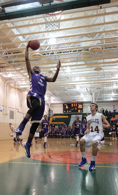 "<div class=""source"">Peter W. Zubaty</div><div class=""image-desc"">Bardstown senior Devonte Grundy climbs the ladder for a first-quarter slam dunk during a 25-6 opening run.</div><div class=""buy-pic""><a href=""http://web2.lcni5.com/cgi-bin/c2newbuyphoto.cgi?pub=191&orig=grundydunk1.JPG"" target=""_new"">Buy this photo</a></div>"