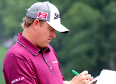 """<div class=""""source"""">DENNIS GEORGE/Contributing Photographer</div><div class=""""image-desc"""">Campbellsville's J.B.Holmes signs an autorgraph during Tuesday's practice round at Valhalla. Play in the 96th PGA starts Thursday in Louisville.</div><div class=""""buy-pic""""></div>"""