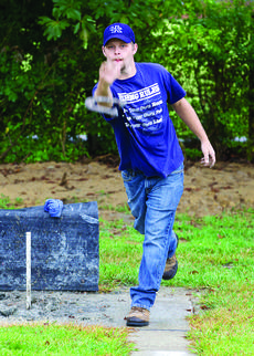 "<div class=""source"">FORREST BERKSHIRE/The Kentucky Standard</div><div class=""image-desc"">Randy ""Buster"" Wade pitches a shoe at the Nelson County Fair Friday night. The horseshoe pitching tournament was canceled because of rain, but that didn't stop some members of the Bourbon City Ringers from tossing a few shoes when the rain tapered off.</div><div class=""buy-pic""><a href=""http://web2.lcni5.com/cgi-bin/c2newbuyphoto.cgi?pub=191&orig=horseshoe_002new.jpg"" target=""_new"">Buy this photo</a></div>"