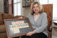 "<div class=""source"">RANDY PATRICK/The Kentucky Standard</div><div class=""image-desc"">Suzanne Hayden displays a Turkish newspaper headline announcing her arrival, in which she is referred to as ""the Huntress.""</div><div class=""buy-pic""><a href=""/photo_select/72596"">Buy this photo</a></div>"