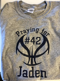 "<div class=""source"">Submitted Photo</div><div class=""image-desc"">T-shirts are being sold to support Jaden in his recovery. They are $10. Anyone interested can contact Matthew Reynolds at the number listed in the article.</div><div class=""buy-pic""></div>"