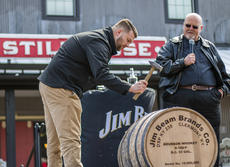 """<div class=""""source"""">KACIE GOODE/The Kentucky Standard</div><div class=""""image-desc"""">Freddie Noe seals Jim Beam's 15 millionth barrel Monday afternoon in front of the American Stillhouse.</div><div class=""""buy-pic""""><a href=""""/photo_select/93673"""">Buy this photo</a></div>"""