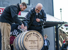 """<div class=""""source"""">KACIE GOODE/The Kentucky Standard</div><div class=""""image-desc"""">Fred and Freddie Noe top off the 15 millionth barrel Monday afternoon during a special presentation at the Jim Beam American Stillhouse.</div><div class=""""buy-pic""""><a href=""""/photo_select/93672"""">Buy this photo</a></div>"""