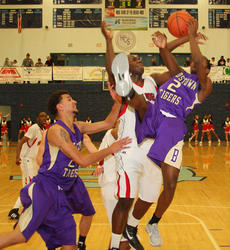 """<div class=""""source"""">Peter W. Zubaty</div><div class=""""image-desc"""">Bardstown senior Anthony Myrks, right, battles with John Hardin's Daveon Greene for a fourth-quarter rebound in Tuesday's 5th Region championship. Myrks scored 21 points in the second half in a furious rally, but the Tigers fell short of back-to-back titles in a 74-66 loss.</div><div class=""""buy-pic""""><a href=""""http://web2.lcni5.com/cgi-bin/c2newbuyphoto.cgi?pub=191&orig=jh_bhs_bbregchamp_04.JPG"""" target=""""_new"""">Buy this photo</a></div>"""