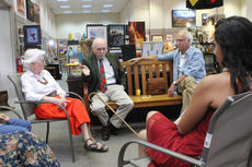 """<div class=""""source"""">RANDY PATRICK/The Kentucky Standard</div><div class=""""image-desc"""">Artist Jim Cantrell answers a question during his reception at the Gallery on the Square.  At left is his wife, Jeannette. Seated beside him is Tom Ballard, and Ballard's granddaughter, Isabelle, is seated in front of him.</div><div class=""""buy-pic""""><a href=""""/photo_select/89929"""">Buy this photo</a></div>"""