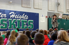 """<div class=""""source"""">KACIE GOODE/The Kentucky Standard</div><div class=""""image-desc"""">In addition to reading a few of her boosk, author Julia Cook encouraged students to write as part of her tour through Bardstown and Nelson County schools. Cook has written more than 80 books for kids that focus on real-world problems and problem solving. Some of the books she shared with local kids addressed having a bad attitude, cyber safety and how to spot kidnappers and child predators.</div><div class=""""buy-pic""""><a href=""""/photo_select/91473"""">Buy this photo</a></div>"""