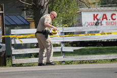"<div class=""source"">RANDY PATRICK/The Kentucky Standard</div><div class=""image-desc"">Deputy Sheriff Kaelen Matthews tapes off the area around an alley where police were interviewing witnesses following a shooting that was reported at 3:22 p.m. Tuesday.</div><div class=""buy-pic""><a href=""/photo_select/74889"">Buy this photo</a></div>"