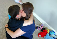 """<div class=""""source"""">KACIE GOODE/The Kentucky Standard</div><div class=""""image-desc"""">Kaleb gives his mom a kiss. He is a very affectionate child. </div><div class=""""buy-pic""""><a href=""""/photo_select/94269"""">Buy this photo</a></div>"""