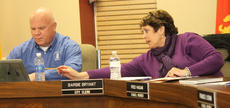 """<div class=""""source"""">RANDY PATRICK/The Kentucky Standard</div><div class=""""image-desc"""">Kathy Graham, executive assistant to Bardstown Mayor John Royalty, points out something to her boss at the start of the City Council meeting Tuesday night.</div><div class=""""buy-pic""""><a href=""""/photo_select/81911"""">Buy this photo</a></div>"""