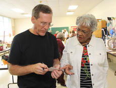 """<div class=""""source"""">RANDY PATRICK/The Kentucky Standard</div><div class=""""image-desc"""">Allen Kraus, who is interested in his grandmother's involvement in establishing the first human rights commission in Kentucky, goes over a list of names with Martha Hickman at St. Monica's Fall Festival Saturday.  </div><div class=""""buy-pic""""><a href=""""/photo_select/89922"""">Buy this photo</a></div>"""