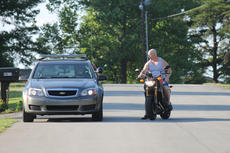 """<div class=""""source"""">RANDY PATRICK/The Kentucky Standard</div><div class=""""image-desc"""">A Kentucky State Police officer questions a motorcyclist in the Dixie Lane neighborhood after a child was injured by a hit-and-run driver Monday.</div><div class=""""buy-pic""""><a href=""""/photo_select/66912"""">Buy this photo</a></div>"""