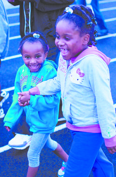 """<div class=""""source"""">RANDY PATRICK/The Kentucky Standard</div><div class=""""image-desc"""">Kiana Hunter and Jayera Hunter hold hands and smile as they walk around the track.</div><div class=""""buy-pic""""><a href=""""/photo_select/47044"""">Buy this photo</a></div>"""