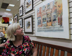 """<div class=""""source"""">RANDY PATRICK/The Kentucky Standard</div><div class=""""image-desc"""">Donna Eaves looks at one of Jim Cantrell's watercolors of a Bardstown scene during his talk Saturday.</div><div class=""""buy-pic""""><a href=""""/photo_select/89926"""">Buy this photo</a></div>"""