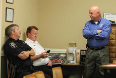 "<div class=""source"">/The Kentucky Standard</div><div class=""image-desc"">Capt. McKenzie Mattingly, Bardstown's acting police chief, talks with Mayor John Royalty before a City Council meeting in May while Fire Chief Randy Walker checks his messages. Mattingly continued to collect overtime while fulfilling the duties of an exempt position, capitalized on a city policy to cash out personal leave and continued to receive the same rate of pay after a new police chief was hired.</div><div class=""buy-pic""><a href=""/photo_select/84810"">Buy this photo</a></div>"