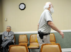 "<div class=""source""></div><div class=""image-desc"">Stephen McBride, Shelbyville, walks out of City Council Chambers with a small semi-automatic pistol in a holster at his side. McBride addressed  Bardstown City Council members about city ordinances he said were unlawful at a regular meeting Tuesday. Eddie Takno, Tokyo, Japan, sits nearby.</div><div class=""buy-pic""><a href=""http://web2.lcni5.com/cgi-bin/c2newbuyphoto.cgi?pub=191&orig=mcbride02.jpg"" target=""_new"">Buy this photo</a></div>"