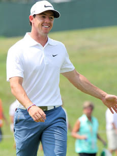 """<div class=""""source"""">DENNIS GEORGE/Contributing Photographer</div><div class=""""image-desc"""">Rory McIlroy smiles as he approaches the first green during Tuesday's practice round at Valhalla. The Irishman is the favorite to capture the 96th PGA.</div><div class=""""buy-pic""""></div>"""