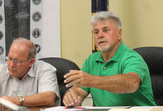 """<div class=""""source"""">RANDY PATRICK/The Kentucky Standard</div><div class=""""image-desc"""">County Magistrate Keith Metcalfe, right, asks a question about the KentuckyWired project in Nelson County possibly competiting with local cable and internet providers.</div><div class=""""buy-pic""""><a href=""""/photo_select/89030"""">Buy this photo</a></div>"""