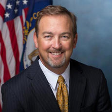 """<div class=""""source""""></div><div class=""""image-desc"""">Mike Mangeot, pictured here in his former official state portrait, was hired Tuesday as the new Bardstown-Nelson County Tourist Commission executive firector. He previously served as the state's commissoner for travel and tourism.</div><div class=""""buy-pic""""><a href=""""/photo_select/92778"""">Buy this photo</a></div>"""