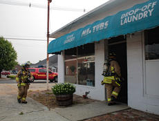 "<div class=""source"">KACIE GOODE/The Kentucky Standard</div><div class=""image-desc"">Firefighters Chris Bleuel and Kevin Grayson file into Mr. Tubs Coin Laundry Tuesday evening after an employee reported smoke in the building. The source was determined to be a dryer that had shorted out, causing minor damage to a wall.</div><div class=""buy-pic""><a href=""/photo_select/67314"">Buy this photo</a></div>"