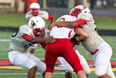 "<div class=""source"">PETER W. ZUBATY/The Kentucky Standard</div><div class=""image-desc"">Nelson County's Demarcus Hamilton, left, and Le'Ander Beckley, right, stack up a Bullitt East ballcarrier for a tackle.</div><div class=""buy-pic""></div>"