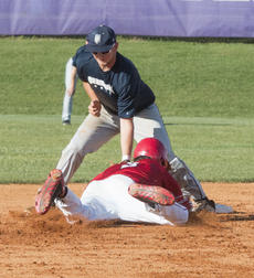 """<div class=""""source"""">PETER W. ZUBATY/The Kentucky Standard</div><div class=""""image-desc"""">Thomas Nelson's Dalton Myers puts the tag on Nelson County's Colton Brewer at second following catcher Kendall Roller's pickoff throw in the Cardinals' 6-0 district first-round win Monday.</div><div class=""""buy-pic""""></div>"""