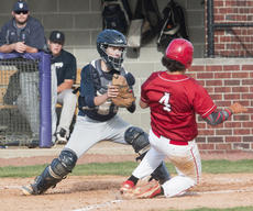 """<div class=""""source"""">PETER W. ZUBATY/The Kentucky Standard</div><div class=""""image-desc"""">Thomas Nelson catcher Kendall Roller wheels to make the tag on Nelson County's Cameron Lovvorn to prevent a run in the Cardinals' 6-0 win Monday in the 19th District tournament's first round. Roller threw out two would-be base-stealers, and also cut down a runner at second on a pickoff throw to help keep his team within striking distance.</div><div class=""""buy-pic""""></div>"""