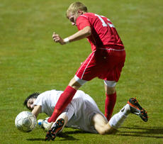 "<div class=""source"">PETER W. ZUBATY/The Kentucky Standard</div><div class=""image-desc"">Thomas Nelson's Kyle Rogers looks back at a ball during the 19th District boys' soccer championship as Nelson County's Kaleb Cecil hovers over top. Rogers and Cecil were teammates at NCHS.</div><div class=""buy-pic""></div>"