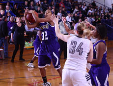 "<div class=""source"">Peter W. Zubaty</div><div class=""image-desc"">Bardstown's Karis Rogers grabs a rebound against Thomas Nelson Monday.</div><div class=""buy-pic""></div>"