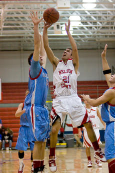 """<div class=""""source"""">Bruce Nichols</div><div class=""""image-desc"""">Dakota Benningfield leaps over Casey County defense in Tuesday night's neck-and-neck game, part of the Norton Suburban Hospital Classic. </div><div class=""""buy-pic""""></div>"""