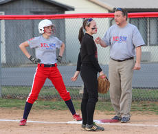 """<div class=""""source"""">Peter W. Zubaty</div><div class=""""image-desc"""">Nelson County coach Chris Mattingly, right, instructs sophomore Katrina Boone after a base hit Wednesday during a scrimmage against Pleasure Ridge Park. The Cardinals open their season Monday at Eastern.</div><div class=""""buy-pic""""><a href=""""http://web2.lcni5.com/cgi-bin/c2newbuyphoto.cgi?pub=191&orig=ncsoft_scrim03.JPG"""" target=""""_new"""">Buy this photo</a></div>"""