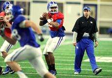 "<div class=""source"">CHET WHITE/UK Athletics</div><div class=""image-desc"">New University of Kentucky offensive coordinator Neal Brown, right, watches the action during spring practice. Brown, a Bardstown native, returns home to Kentucky after successful stints at Texas Tech and Troy, where his offenses were among the most productive in Division I-A football.</div><div class=""buy-pic""></div>"