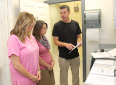 """<div class=""""source"""">RANDY PATRICK/The Kentucky Standard</div><div class=""""image-desc"""">Donny Gill, harm reduction manager for the Lincoln Trail District Health Department goes over needle exchange program instructions with Nelson County Health Department employees Tammi Moore, left, the clinical director, and Melanie Castile, the senior support supervisor.</div><div class=""""buy-pic""""><a href=""""/photo_select/88894"""">Buy this photo</a></div>"""