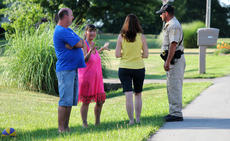 """<div class=""""source"""">RANDY PATRICK/The Kentucky Standard</div><div class=""""image-desc"""">Neighbors in front of 2009 Dixie Lane talk with Nelson County Deputy Sheriff Jerry Hardin about an accident involving a small child that happened before 6:41 p.m. Monday.</div><div class=""""buy-pic""""><a href=""""/photo_select/66913"""">Buy this photo</a></div>"""