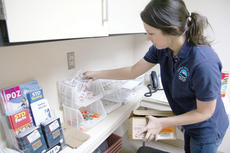 "<div class=""source"">Photo by The Jessamine Journal</div><div class=""image-desc"">An employee of the Lexington-Fayette County Health Department stocks the department's supply of clean needles provided to drug addicts to reduce the prevalence of bloodborne pathogens.</div><div class=""buy-pic""><a href=""/photo_select/81672"">Buy this photo</a></div>"
